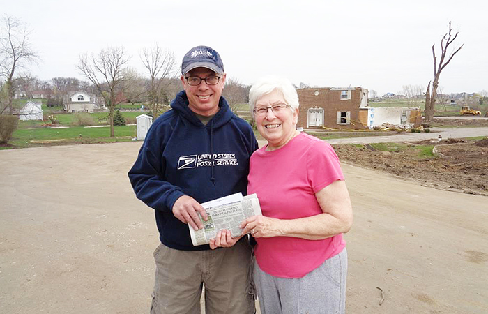 Rochelle, IL, Rural Carrier Joel Reese and a customer whose home was damaged by a tornado